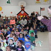 Staff photo by Cathy Spaulding<br /> Madison Tomlinson, state coordinator for OKCharacter.org, videos Early Childhood Center students as they do a cheer. Tomlinson was at ECC to present the school with a State School of Character award.