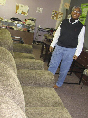 Staff photo by Cathy Spaulding<br /> Traci McGee operates a furniture store along with her insurance agency. She said customer service is a key to good business.