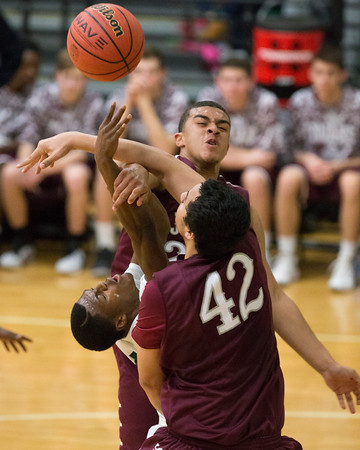 Phoenix special photo by Von Castor<br /> Muskogee's Tavian Davis gets fouled hard by Jenks' Cole Surrett, back, and Isaac Gilton, front, during Friday's game at Ron Milam Gymnasium.