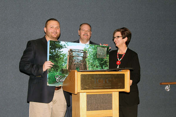 Special photo by Travis Sloat<br /> County Commissioner Ken Doke was presented with a keepsake photograph of the old Fort Gibson bridge at Thursday's Chamber of Commerce banquet. Outgoing Chairman David Perry and Executive Director Sue Godwin presented the photo.