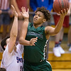 Muskogee's CJ Parks, left, shoots over a Bixby defender Monday in the Roughers' 68-65 win at Bixby High School.