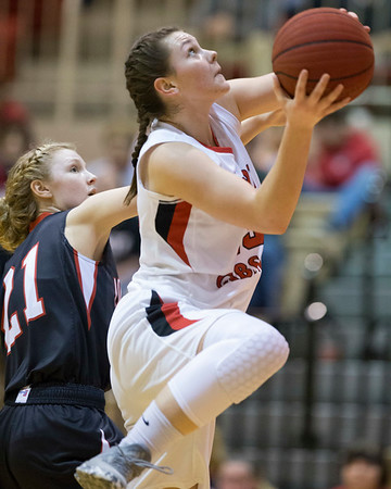 Phoenix special photo by Von Castor<br /> Fort Gibson's Zoe Shieldnight, right, drives in for a layup past Locust Grove's Regan Torrey during Tuesday's game at Harrison Field House. The Class 4A No. 1 Lady Tigers remained undefeated with a 66-39 win.