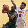 Special photo by Von Castor<br /> Muskogee's Chris Mims, left, goes up for a bucket and avoids Union's Equann Brown during Monday's game at Union High School.