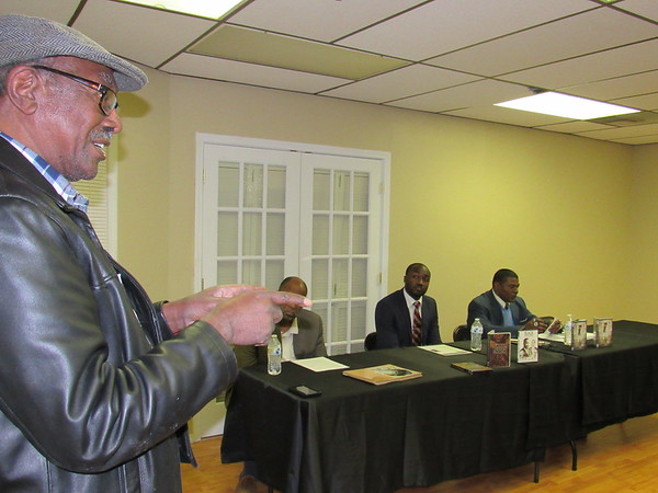 Staff photo by Cathy Spaulding<br /> Retired Muskogee educator Cedric Johnson, left, speaks during a discussion about Black History Month and its relevance for youth today. Panelists were, seated, from left, Jimmie White, James Tolbert and Scott Patton.
