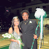 CATHY SPAULDING/Muskogee Phoenix <br /> D'Asia Brown holds her flowers and Kaleb Biglow holds tulle a scepter Friday night after being named Muskogee High School Spring Homecoming queen and king.