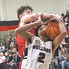 JOHN HASLER/Phoenix Special Photo<br /> Hilldale Hunter Parson fouls Wagoner Bristo Love in Friday's game.