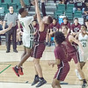 ABIGAIL WASHINGTON/Phoenix Special Photo<br /> Muskogee's Jaraun Campbell shoots over Jenks Chase Conkling
