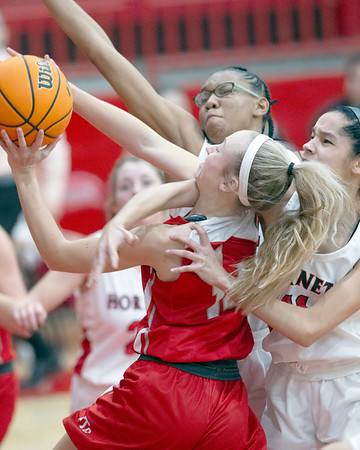 VON CASTOR/Special to the Phoenix<br /> Fort Gibson's Jenna Whiteley is fouled in the lane by Hilldale's Mariah Maxwell, right, as HIlldale's Nevaeh Johnson, back, tries to block Tuesday night at Hilldale. The Lady Tigers won 66-33.