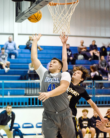 CHRIS CUMMINGS/Special to the Phoenix<br /> Haskell's Zane Adams, left, attempts to put back a rebound for a score in front of a Summit Christian defender during Tuesday's game in Haskell. The Haymakers won 90-66.