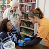 Staff photo by Mike Elswick<br /> Central Baptist Church's faith community nurse Catherine White, center, watches as Connors State College nursing student Alicia Campanella performs a tuberculosis test on Camille Sciscoe on Tuesday at the church. The Central Baptist congregation has hosted White as a faith community nurse for the past six years.