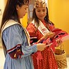 Staff photo by Mike Elswick<br /> Junior Miss Cherokee Danya Pigeon, left, and Miss Cherokee Madison Whitekiller look over some of the donated handmade Valentine cards they and other Cherokee Nation representatives passed out Friday at the Jack C. Montgomery VA Medical Center in Muskogee.