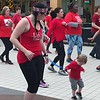 Staff photo by Mike Elswick<br /> Lincoln Waters, 2, works at getting in step with his mother, Heather Waters during a Zumba dance demonstration put on by a group of Strictly Fitness on Friday at Arrowhead Mall as a part of the annual Go Red for Women Heart Walk.