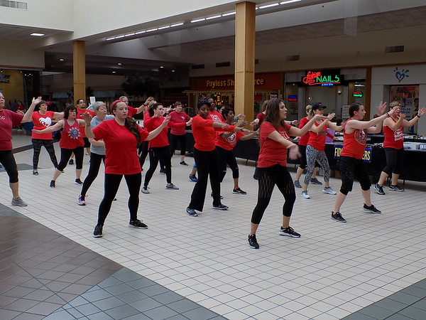 Staff photos by Mike Elswick<br /> Strictly Fitness Zumba class members perform a demonstration  Friday at Arrowhead Mall as a part of the annual Go Red for Women Heart Walk.