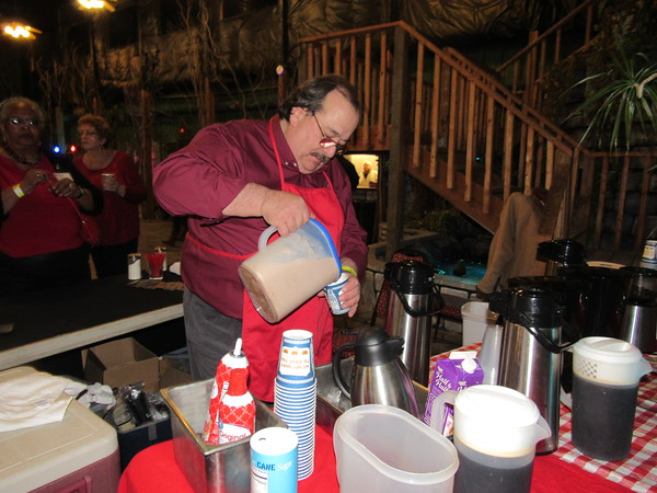 Staff photo by Cathy Spaulding<br /> John Vecchio pours a hot mocha beverage Saturday night at the Habitat for Humanity Home Sweet Home Chocolate Festival. He said the cold weather made his hot beverages popular.
