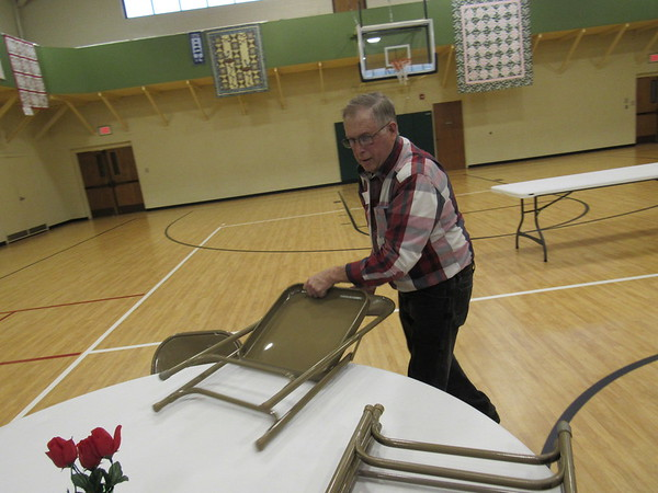 Staff photo by Cathy Spaulding<br /> Virgil Rose moves chairs in preparation for the weekly Dinner Church at St. Paul United Methodist Church. He serves the church in a variety of ways.
