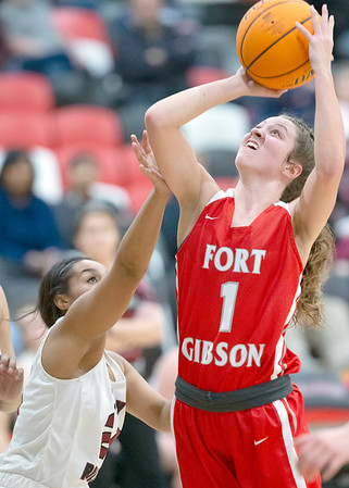 VON CASTOR/Special to the Phoenix<br /> Fort Gibson's Zoey Whiteley, right, shoots over Wagoner's KyKy Swanson Tuesday night at Wagoner. The Lady Tigers won 69-24.