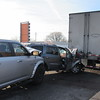 Staff photos by Cathy Spaulding<br /> Muskogee Police and emergency crews investigate a three-vehicle collision Monday morning on South Main Street. A Muskogee woman was taken to the hospital Monday morning after being involved in a three-vehicle wreck on South Main Street. Muskogee Police Officer Rickie Kubiak said a sports utility vehicle driven by 43-year-old   Yolanda Zuniga had stopped behind a southbound tractor-trailer rig, which had stopped on South Main Street between the Columbus Street overpass and Elgin Street. Kubiak said a southbound 2015 Dodge Ram truck driven by Logan Murry Littrell, 39, hit Zuniga's vehicle, pushing it into the tractor-trailer rig. He said police responded around 8:36 a.m. Kubiak said Zuniga was taken to Saint Francis Hospital Muskogee. Zuniga was treated and released, a hospital spokeswoman said. Littrell was cited for failure to yield, Kubiak said. He said seat belts were in use, and airbags deployed in the Dodge truck and the SUV.