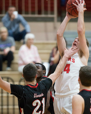 Phoenix special photo by Von Castor<br /> Fort Gibson's Andrew Rumbley, right, shoots over Hilldale's Kaden Kerr during Tuesday's game at Harrison Field House.