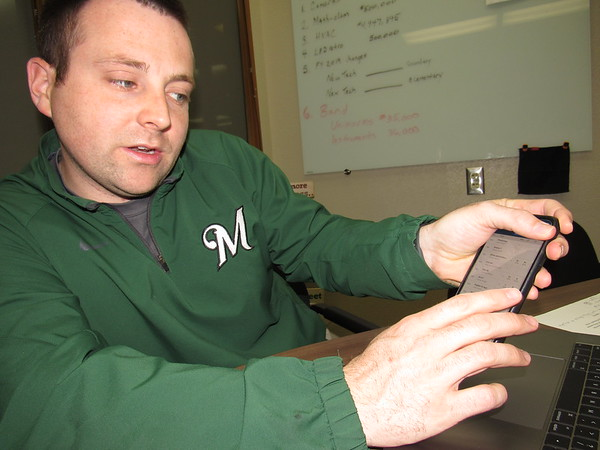 Staff photo by Cathy Spaulding<br /> Muskogee Public Schools Technology Director Eric Wells shows the easy accessibility of an app that tracks a student's attendance, grades, college credit progress and other data.