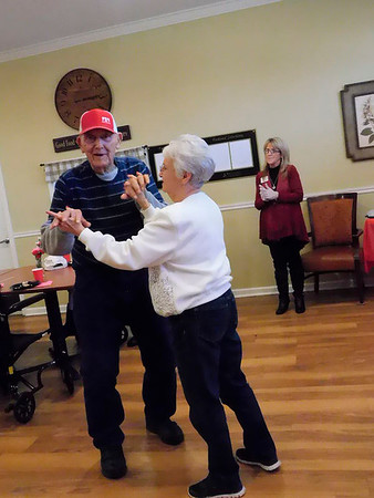 KENTON BROOKS/Muskogee Phoenix<br /> Orville and Gail Holmes, crowned as the King and Queen of the Valentine's Day event at Brookdale Muskogee, take their turn on the dance floor while Muskogee's Braylon Dedmon played the saxophone. The facility treats patients with various form of Alzheimer's disease. Orville has lived there for five years, said daughter Debra Clayton.
