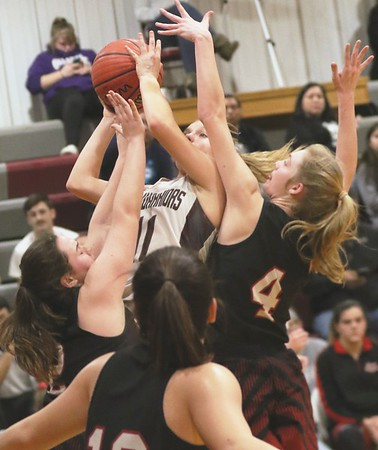 JOHN HASLER/Phoenix Special Photo<br /> Webbers Falls' Samantha Shanks scores over a swarming Caney defense in the Class B regional semifinal played Thursday at Webbers Falls.