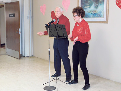 """KENTON BROOKS/Muskogee Phoenix Bob Cockle, left, and Betty Honea sing """"Ain't We Got Fun"""" on Thursday at the reunion for the rehabilitation center at Saint Francis Hospital Muskogee. The couple loves to perform together. The reunion was to bring former patients, called graduates, of the rehab center together."""