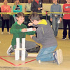 CATHY SPAULDING/Muskogee Phoenix<br /> Alice Robertson Junior High student Tucker Perkins, left, holds paper while teammate Jace Speir tapes it together during the Paper Tower Building preliminary competition Thursday during the Math and Engineering Competition.