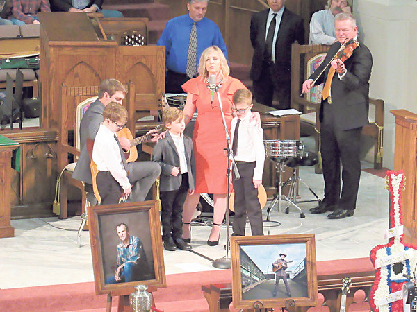 """CATHY SPAULDING/Muskogee Phoenix<br /> Valerie Blair Henderson is joined by her children as she sings """"What a Friend We Have in Jesus"""" at the funeral of her father, Jim Paul Blair."""