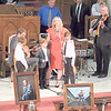 "CATHY SPAULDING/Muskogee Phoenix<br /> Valerie Blair Henderson is joined by her children as she sings ""What a Friend We Have in Jesus"" at the funeral of her father, Jim Paul Blair."
