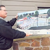 KENTON BROOKS/Muskogee Phoenix<br /> Greenleaf State Park Manager John Kilgore admires the artist rendering of the splash pad being built on the same area where the 70-year-old swimming pool was located. The pad is expected to be completed in March, Kilgore said. The area will also include bathrooms, pavilions, concession and a bath house.