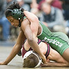 Phoenix special photo by Von Castor<br /> Muskogee's Kyri Beasley gets in a dominating position against Jenks' Branden Elrod during their 126-pound bout in the Class 6A East Regional on Friday in Broken Arrow. Beasley lost by a 9-6 decision.