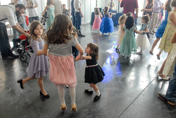 CHESLEY OXENDINE / Muskogee Phoenix <br /> Dads and daughters danced away the afternoon to a variety of music at the Magical Daddy Daughter's Dance Saturday afternoon.