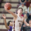VON CASTOR/Special to the Phoenix<br /> Warner's Jack Van Daley shoots from under the basket as he gets past a Sallisaw Central defender Saturday night at Warner. The Eagles captured the Class 2A Area II district title with a 75-61 win.