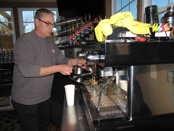 Staff photo by Cathy Spaulding<br /> Jim Dum prepares a coffee beverage at Jim and Em's Coffee, which he has owned for nearly five years.