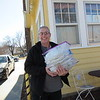Staff photo by Cathy Spaulding<br /> Jim Dum carries prepared pie crusts for the quiches served at Jim and Em's Coffee.