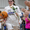 SHANE KEETER/Special to the Phoenix<br /> Savanna Dishman carries flowers coming onto the court in honor of fellow player, Jessi Haworth, who died Saturday in a single-vehicle crash on Oklahoma 10 Saturday. The Wildcats faced off against Buffalo Valley in Class B district championship. Braggs won 49-41. Story in Sports.