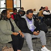 KENTON BROOKS/Muskogee Phoenix<br /> Priscilla Myers, left, and Trecol Myers answer questions on their smartphones at Muskogee Public Schools community forum at the Dr. Martin Luther King Jr. Community Center on Monday. The forum was to introduce the Continuous Strategic Improvement Plan as part of a five-year plan for the school district by Muskogee Public School Superintendent Dr. Jarod Mendenhall. Another set of community forums are scheduled for April 3 and 4.