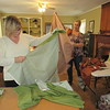 Kathy Dickson of Oklahoma City, left, and Kimberly Wageman-Prack of the Nash Farmstead rip fabric for reproductions of historic dresses during a dressmaking workshop held Friday and Saturday at Fort Gibson Historic Site.