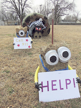 CATHY SPAULDING/Muskogee Phoenix<br /> Square bale Minions seek help in a hay bale display promoting the Muskogee Regional Junior Livestock Show