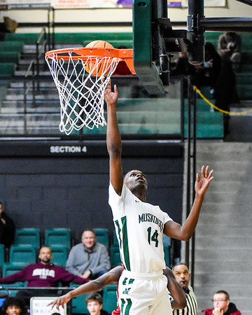 CHRIS CUMMINGS/Special to the Phoenix<br /> Muskogee's Jeraun Campbell drops in a layup in Tuesday's home finale against Owasso.