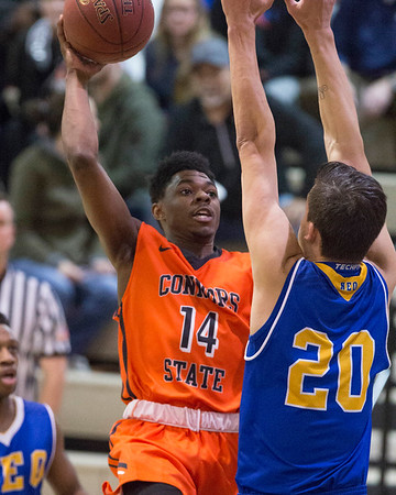 Phoenix special photo by Von Castor<br /> Connors' Darius Ray shoots over NEO's Dylan Van Eyck Thursday night at Connors in Warner.