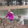 CATHY SPAULDING/Muskogee Phoenix<br /> Five-year-old Bella Jobe and 4-year-old Anna Jobe climb through bald cypress knees by the Honor Heights Park duck pond. Anna and Bella Jobe spent Friday afternoon with their great-grandfather, Bill Csizmedia, at Honor Heights Park. Csizmedia said they had waited several months for the park to open for vehicular traffic.