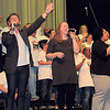 Staff photo by Cathy Spaulding<br /> Singers, backed by a multi-church choir, lead praise and worship at One Blood Revival, held Monday night at Muskogee Civic Center.