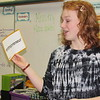 Staff photo by Cathy Spaulding<br /> Muskogee High student Riley Huston sounds out a new word during a recent JA in a Day session at Irving Elementary. The program teaches youngsters about finance.
