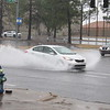 Staff photo by Cathy Spaulding<br /> Vehicles splashed through the intersection of Seventh Street and Okmulgee Avenue during Tuesday showers. At least 1.4 inches of rain fell on Muskogee by 4 p.m. Tuesday, according to the AccuWeather website. Tuesday's wetness is expected to give way to partly cloudy skies on Wednesday with more rain expected Thursday afternoon and Friday.