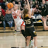 SHANE KEETER/Special to the Phoenix<br /> Okay's Lexi Erb gets around Cameron's Cameron Hannah McCormick in Class A regional playoff action Thursday at Okay.