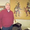 CATHY SPAULDING/Muskogee Phoenix<br /> Bacone College President Ferlin Clark stands by a work by a Kiowa artist as he talks about Bacone art works to be displayed at the Oklahoma History Center in March.