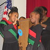 CATHY SPAULDING/Muskogee Phoenix<br /> New Tech at Cherokee Elementary students Reaquel Hopkins, left, and Alexia Beasley recite an inspirational poem during the school's Black History Month assembly Friday. The two also joined in an African dance.