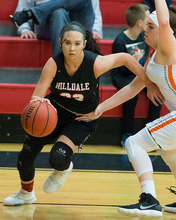 Phoenix special photo by Von Castor<br /> Hilldale's Makayla Williams drives past Roland's Cassidy Floyd to get a shot in the lane during Friday's Class 4A girls regional game at the Hilldale Event Center. The Lady Hornets lost 51-20 and will play Tecumseh at 1:30 p.m. today at Checotah High School.