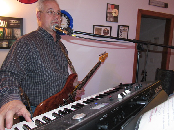 Derek Gibson plays keyboards and guitar during a practice with his group, Second Wind. The group has performed at Oklahoma Music Hall of Fame.